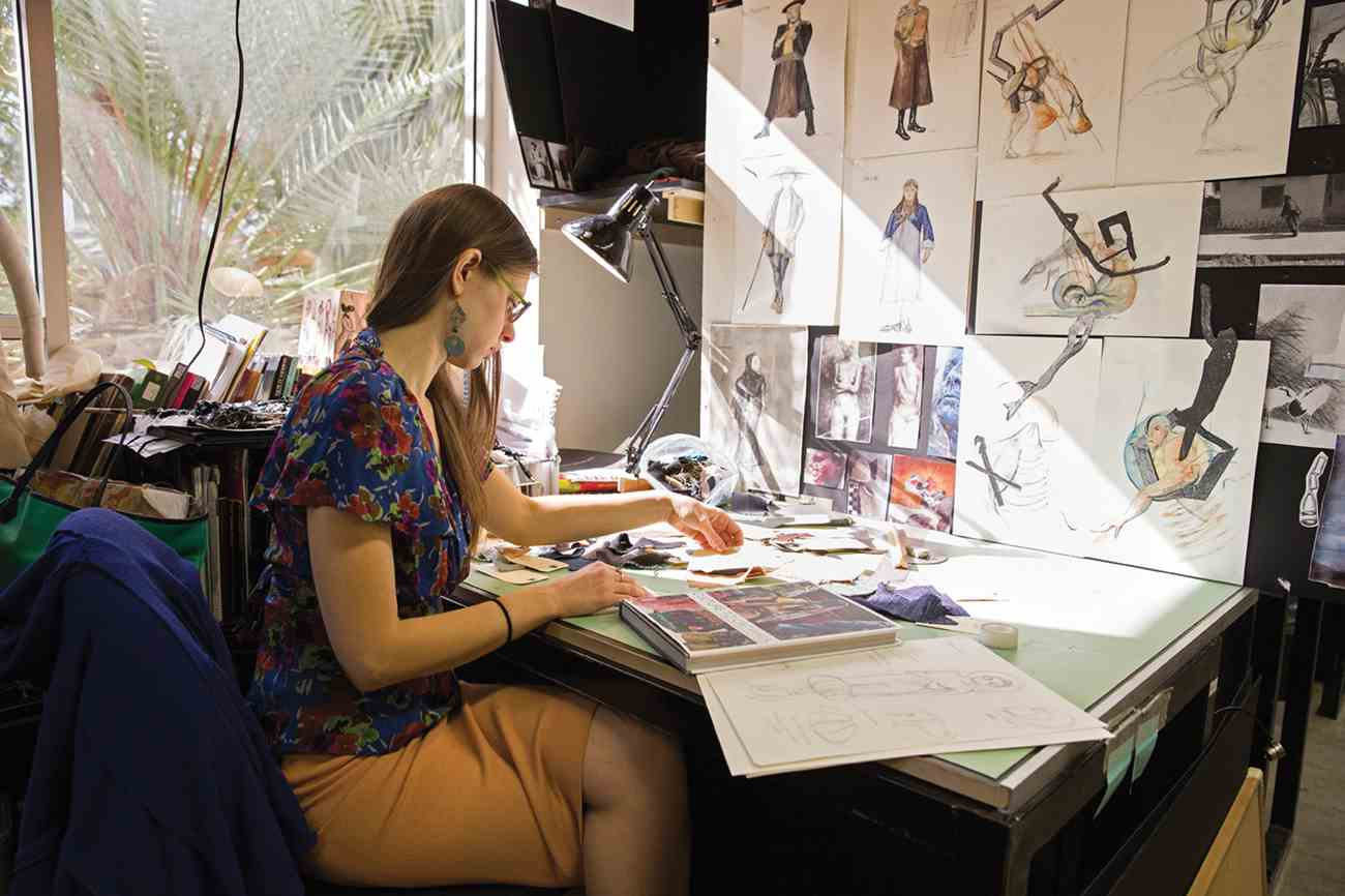 MFA Costume Design student Lena Sands working in the School of Theater's Design Studio